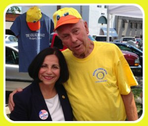 This photo epitomizes Bill Meyer. He's volunteering at the Great Duck Race, sponsored by Sunrise Rotary, while hugging Republican State Senator Toni Boucher.