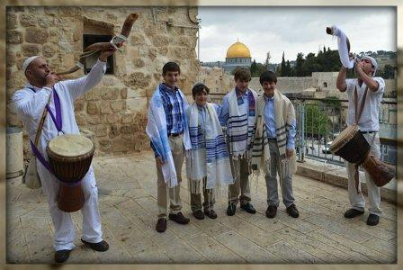 Shofars blow at the Western Wall, during the inspiring bar mitzvah service.