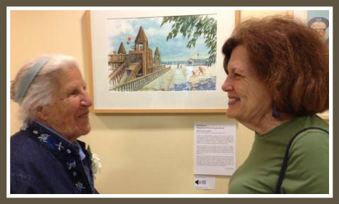 "90-year-old Lucia Nebel White and Linda Gramatky Smith -- daughter of the ""Little Toot"" artist -- admire Al Willmott's Compo Beach playground painting."