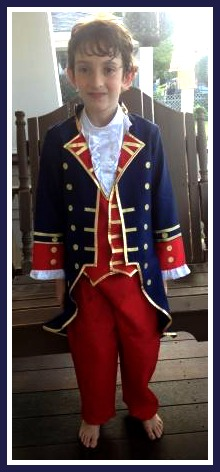One boy proudly wore his colonial outfit...