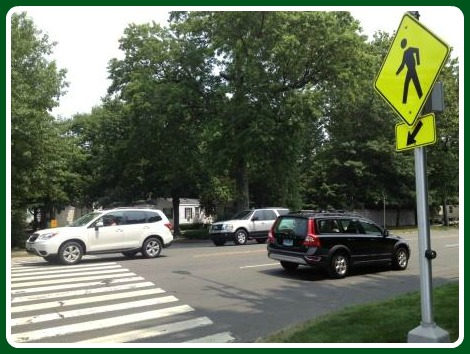 The crosswalk sign -- with tiny lights -- at tje Landsdowne condominiums, opposite 1655 Post Road East.