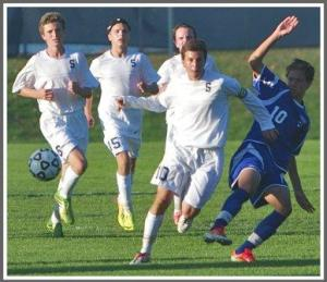 Diego Alanis (front) and Michael  Reid, Jack Scott and Charlie Leonard play swarming soccer. (Photo/Kim Lake)