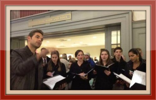 The Staples Orphenians, led by director Luke Rosenberg, at last year's Christ & Holy Trinity Church celebration.