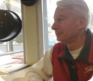 John Brandt, in his familiar corner seat.