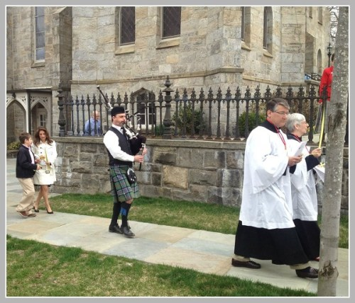 Music and religious rites combined as the Palm Sunday procession began.
