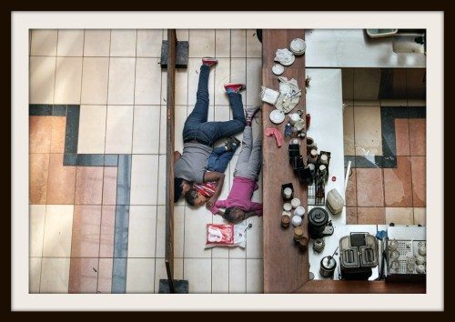 A woman tried to shelter children from gunfire by Somali militants at the Westgate mall in Nairobi, Kenya, in an attack that killed more than 70 people. Tyler Hicks made this photo from a floor above, in an exposed area where the police feared for his safety. (Tyler Hicks, The New York Times - September 23, 2013)