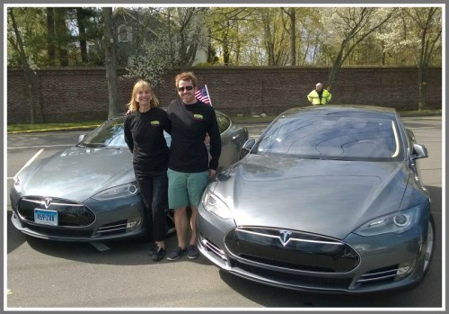Robin Tauck, Robert Brickley and their Teslas.