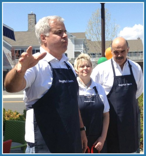 Saugatuck Sweets owners Al DiGuido (left) and Pete Romano, with Al's wife Chris, welcome a large crowd to Saugatuck's newest cool spot.