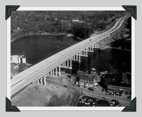 Construction in 1957 of the Connecticut Turnpike bridge in Saugatuck. Charles Street feeds into Riverside Avenue (bottom). Note the Gault tanks along the river (upper left).