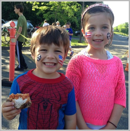 It doesn't get better than eating pizza and wearing USA face paint. (Photo/Doug Fincher)
