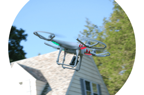 Rick's drone, inspecting a roof.