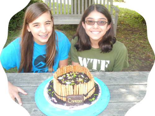 Hannah (left) and Nina with one of their intriguing, farm-related creations. (Photo/Carrie Aitkenhead)