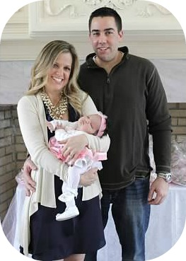 Laura and  John Loffredo, with their daughter.