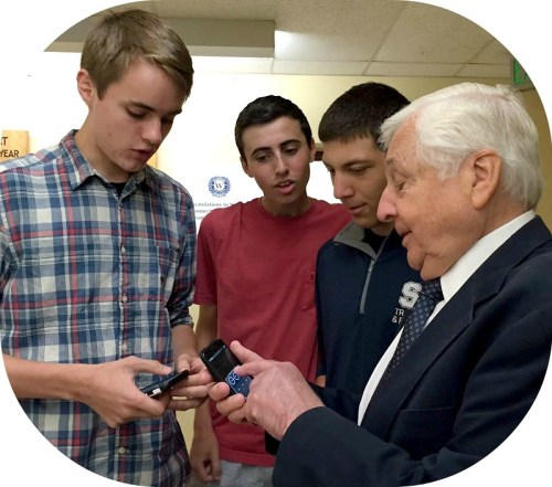 Liam Abourezk, BK Browne and Jack Sila showed superintendent of schools Dr. Elliott Landon how they used QR codes on their smartphones, as part of a Staples High project involving art, writing and history.