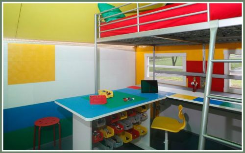 Another view of the interior. Check out all the Lego materials under the desk -- and the bunk bed for