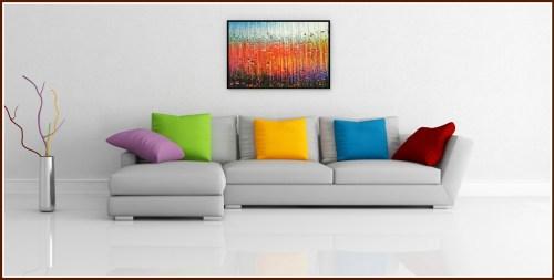 Soundwall art hangs above a sofa.