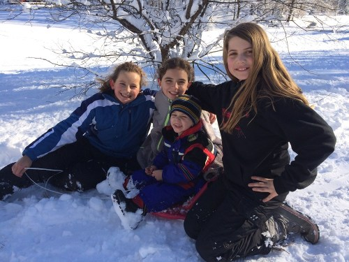 Bella Sabino, Georgia Graham, Sienna Peck and Evan Sabino enjoying the snow at Winslow Park today. (Photo/Lisa Sabino)