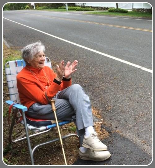 Joyce Bottone's mom cheering cyclists