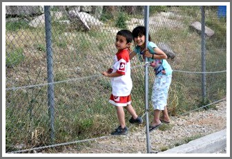 Two of the many children in a Lesbos Island refugee camp.