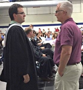 James D'Amico (left) and former Staples High School principal John Dodig chat during the 2016 graduation ceremony.