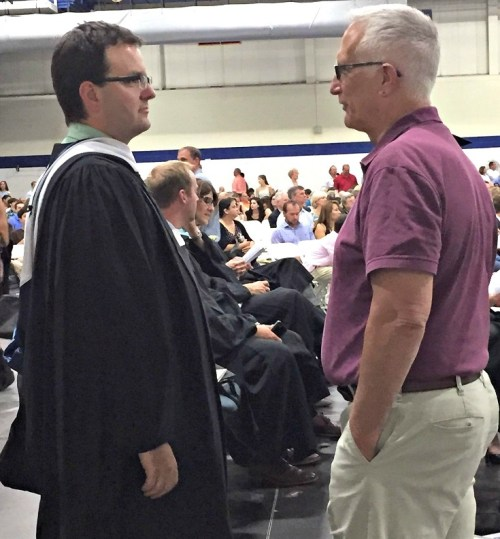 Former principal John Dodig (right) and incoming principal James D'Amico chat.