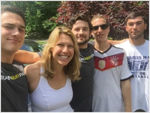 A grateful Westporter, surrounded by Staples interns (from left) Jack Griffin, Josh Willis, Jack Zeldes and Sam Arciola.