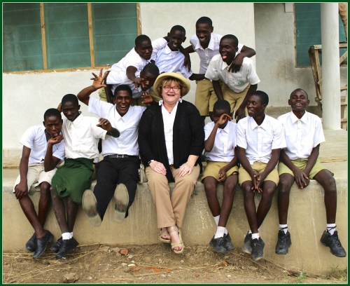Martha Deegan, with some of the boys she's helped. (Photo/Thor Deegan)