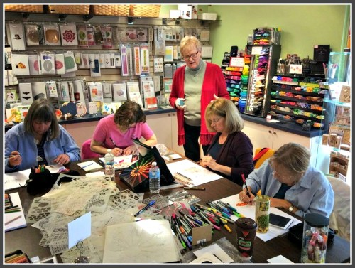 Judy Ritchie (standing), with customers hard at work during a class. (Photo/Michael Trent)