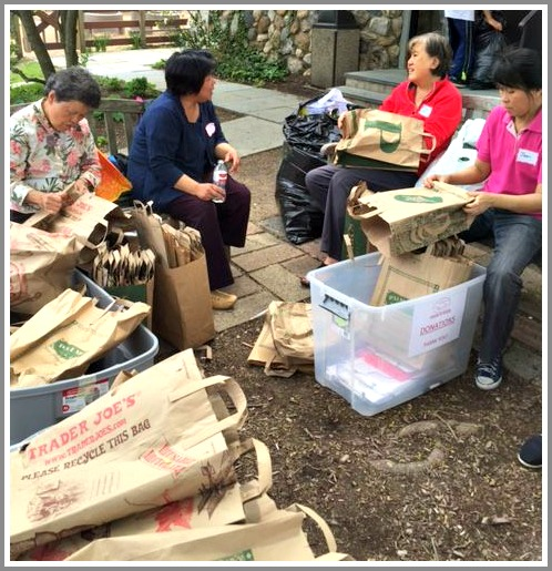 Organization of Chinese Americans working at a food drive last spring.
