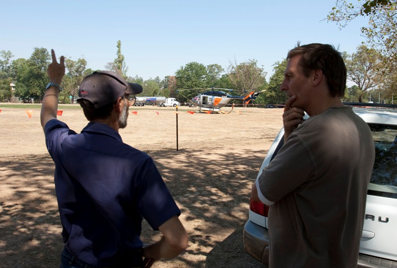 Carr and Edwin near helicopters in Alexandra