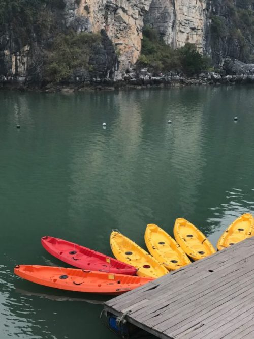 Kayaking floating village Halong Bay Vietnam