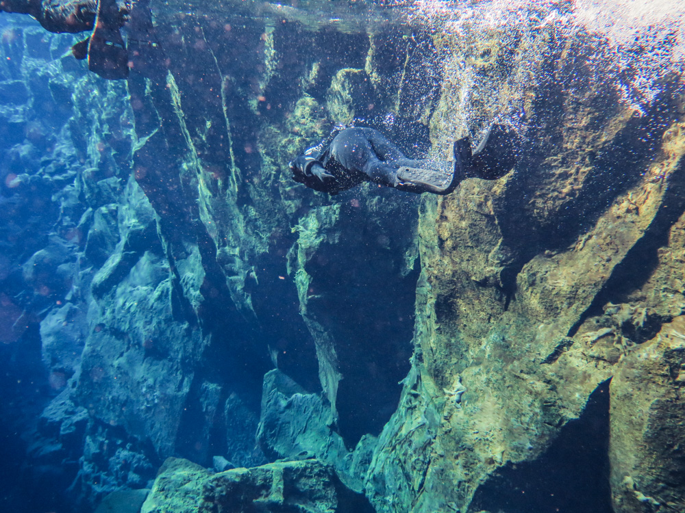Silfra fissure is a place in Iceland where the Eurasian and North American continents drift apart and you can swim in between those two tectonic plates!
