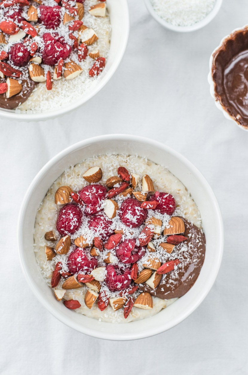 Almond Cacao Oatmeal with Raspberries, Goji and Coconut served as a delicious breakfast is a great start of the day, filling you up with vitamines, minerals, antioxidants and fiber.