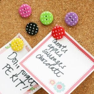 A photo of colourful polka dots push pins