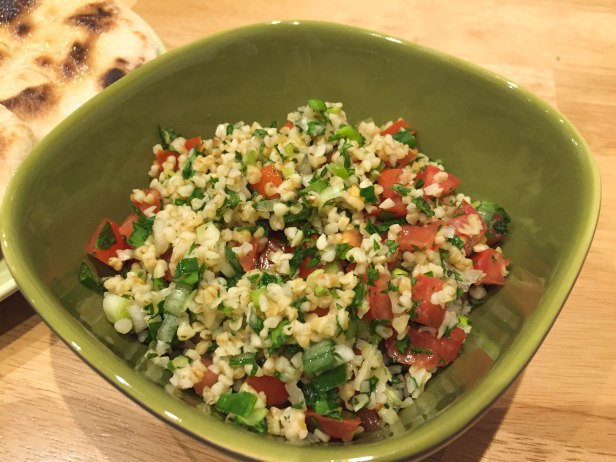 Freshly made tabbouleh served in a square green bowl