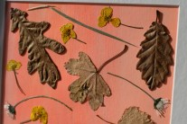 A photograph close up showing the texture of the paint on the card as well as the natural texture of the flowers and leaves