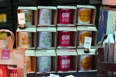 A photograph of mugs for sale with funny gin slogans