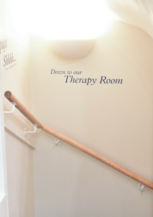 A photograph of the stairs leading to the Therapy Room