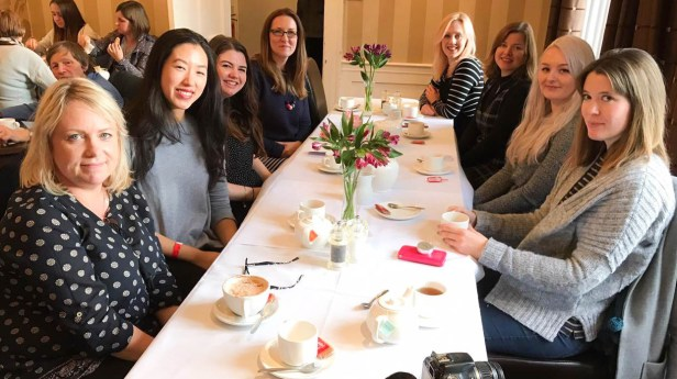 A photograph of the bloggers enjoying tea and cake at The Almonry