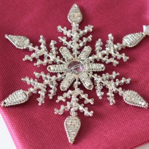 A photograph of the silver snowflake that Emma bought