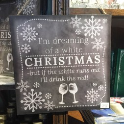 "A photograph of a blackboard sign at Ely Gin saying, ""I'm dreaming of a white Christmas, but if the white runs out I'll drink the red"""
