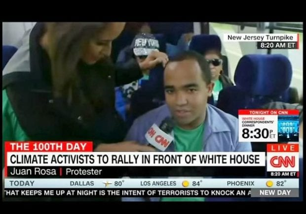 Climate-March-CNN-Protester-Bus-w-border-e1493473563605-620x435