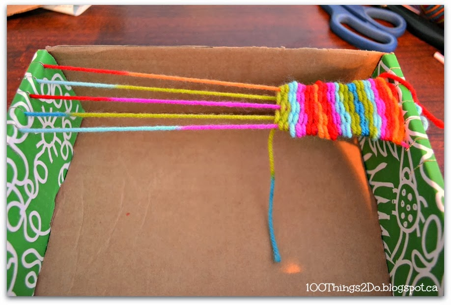 Use a cardboard box and yarn to create your own loom!