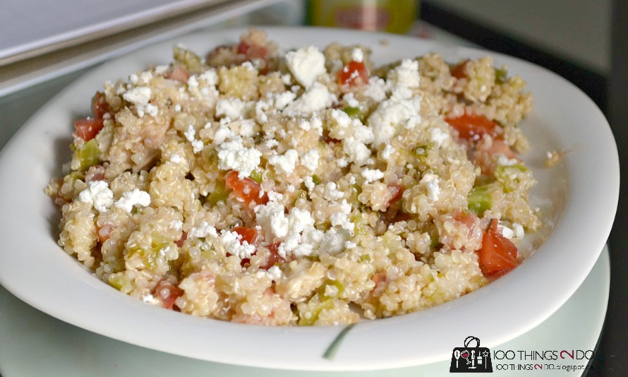quinoa salad topped with goat cheese in a dish
