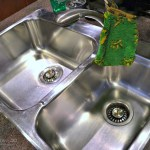 Clean stainless steel sinks to a polished finish
