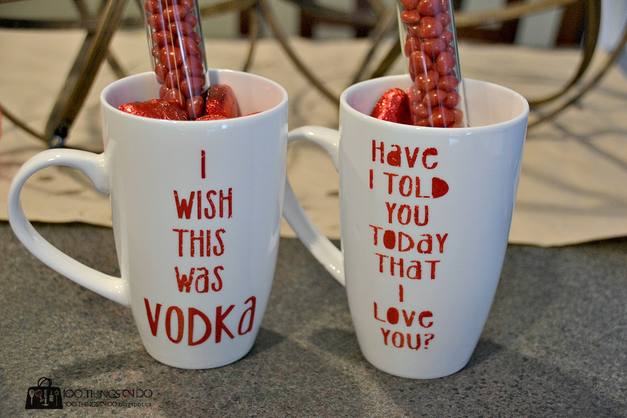 "two mugs filled with Valentine's treats - ""I wish this was Vodka"" and ""Have I told you today that I love you"""