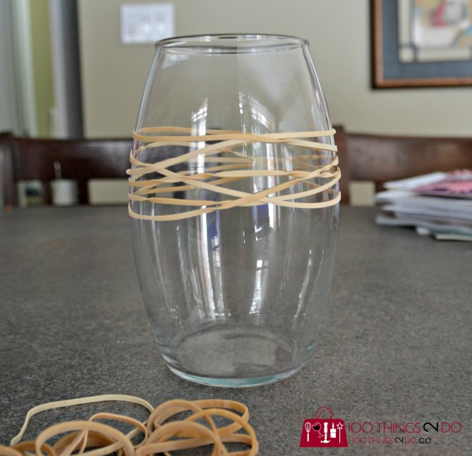 Elastic bands wrapped around a glass vase