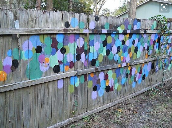 fence art 25 pieces of art using a backyard fence as the. Black Bedroom Furniture Sets. Home Design Ideas
