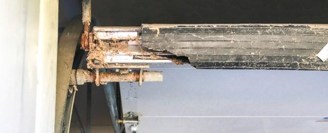 damaged weatherstrip on the bottom of garage door