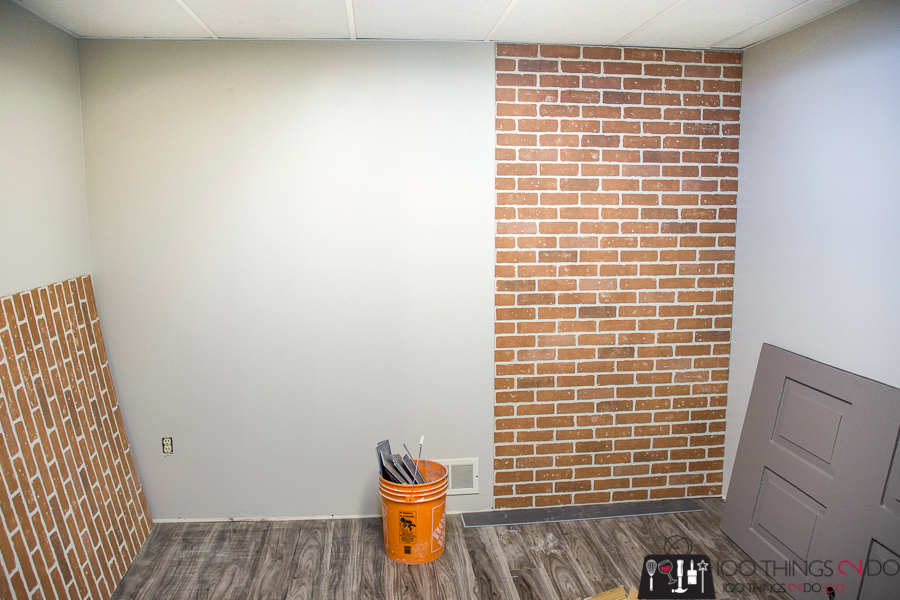 installing faux brick panelling into a basement office